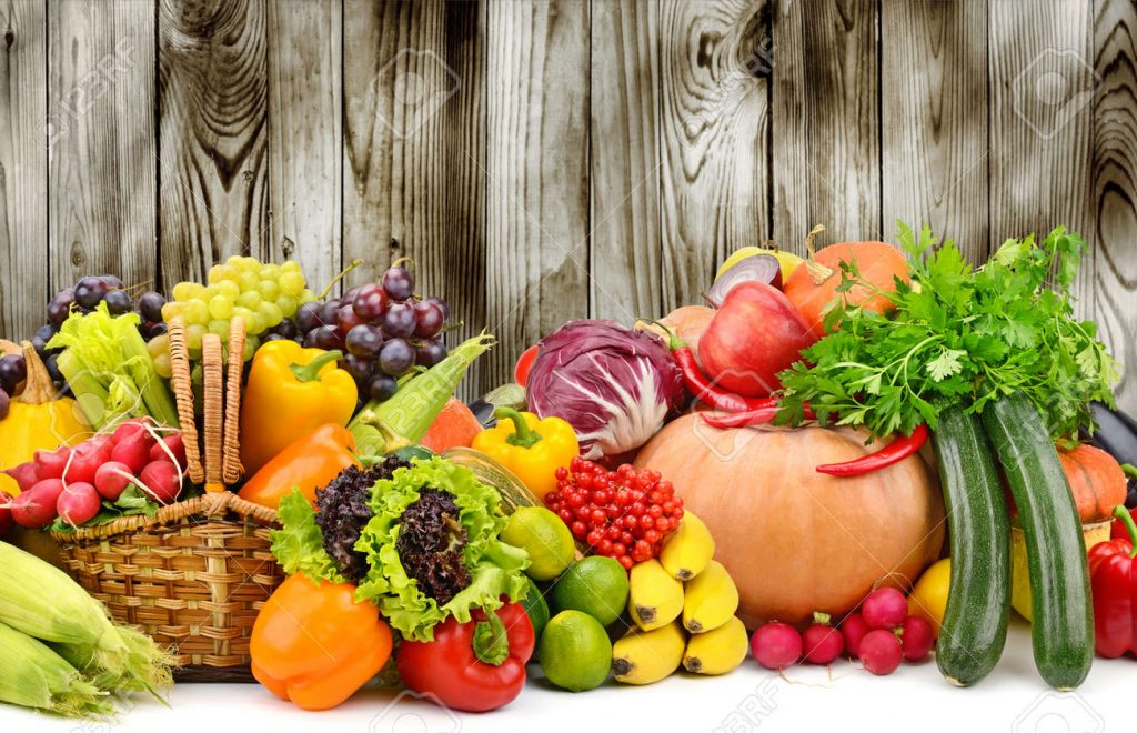 ripe-fruits-and-vegetables-on-dark-wooden-background